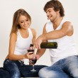 Foto Stock: Cheerful young couple drinking wine