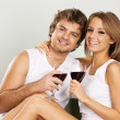 Cheerful young couple drinking wine — Stockfoto