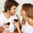 Cheerful young couple drinking wine — Stok fotoğraf