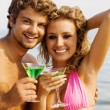 Young couple with cocktails on the seaside — Stock Photo #5758346