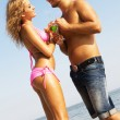 Young couple with cocktails on the seaside — Stock Photo #5758361