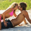 Young passionate couple on the seaside - Stock Photo