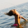 Pretty girl having fun in the water - ストック写真