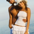 Young stylish couple on a sea shore — Stock Photo