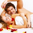 Beautiful couple in bedroom — Stock Photo #5758451