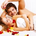 Beautiful couple in bedroom — Stock Photo #5758451
