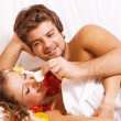 Beautiful couple in bedroom — Stock Photo