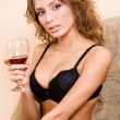 Beautiful woman drinking red wine — Stock Photo #5758453