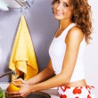 Young beautiful woman washing vegetables — Stock Photo #5758465