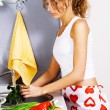 Young beautiful woman washing vegetables — Stock Photo #5758467