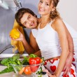 Young romantic couple in the kitchen — Stock Photo #5758469