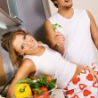 Young romantic couple in the kitchen — Stock Photo #5758472