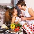 Young romantic couple in the kitchen — Stock Photo #5758474