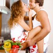Young couple having fun in the kitchen - Foto de Stock  