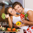 Stock Photo: Young romantic couple in kitchen