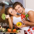 Young romantic couple in the kitchen - Stock Photo