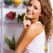 Cheerful young woman with fresh vegetables — Stock Photo