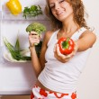 Cheerful young woman with fresh vegetables — Stockfoto