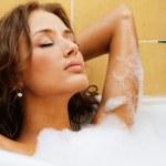 Beautiful woman relaxing in a bath — Stock Photo