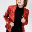 Beautiful model in red leather jacket — Stock Photo