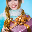 Festive girl with Christmas gift — Stock Photo #5758609