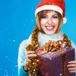 Festive girl with Christmas gift — Stockfoto
