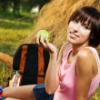 Lovely girl having a rest on picnic — Stock Photo