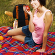 Lovely girl on picnic - Stock Photo