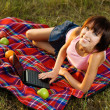 Stock Photo: Lovely girl having a rest outdoors