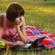 Lovely girl with laptop on picnic — Stock Photo #5758649