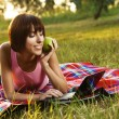 Lovely girl with laptop on picnic — Stock Photo