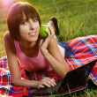 Lovely girl with laptop in the park — Stockfoto #5758651