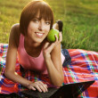 Lovely girl with laptop on picnic — Stock Photo #5758652