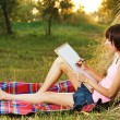 Lovely girl drawing in the park - Stock Photo