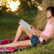 Lovely girl drawing in the park — Stock Photo