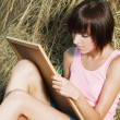 Stock Photo: Lovely girl drawing in park