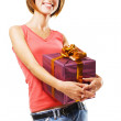 Lovely girl with a gift box — Stock Photo