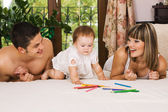 Happy parents playing with little daughter — Stock Photo