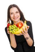 Hermosa joven con un montón de frutas — Foto de Stock