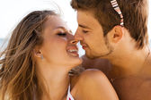 Young beautiful couple kissing on the seaside — Stock Photo