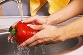 Washing a paprika — Stock Photo