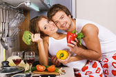 Young romantic couple in the kitchen — Stock Photo