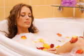 Young woman relaxing in a bath — Stock Photo