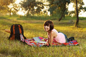 Lovely girl on picnic in the park — Stock Photo