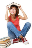 Funny student girl with books — Стоковое фото