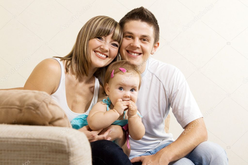 Happy young parents with their little daughter having fun at home  — Stock Photo #5757788