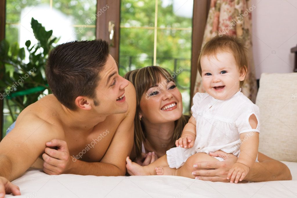 Happy young parents with their little daughter having fun at home   Stock Photo #5757817