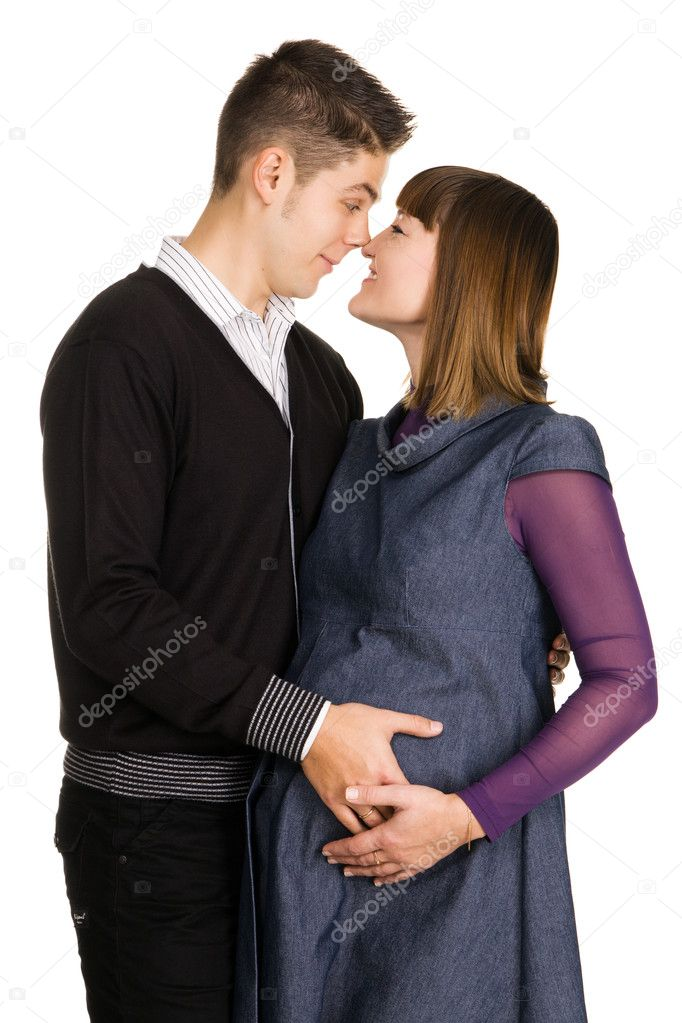 Beautiful pregnant woman with her husband studio portrait  Stock Photo #5757836
