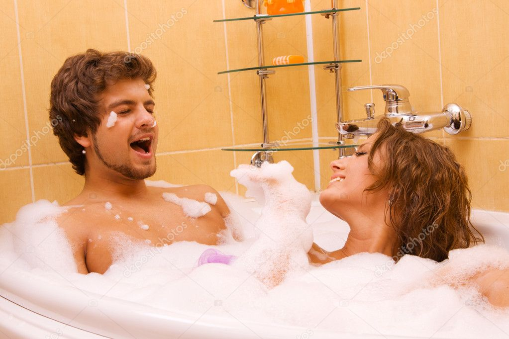 Beautiful young couple enjoying a foamy bath  Stock Photo #5758045