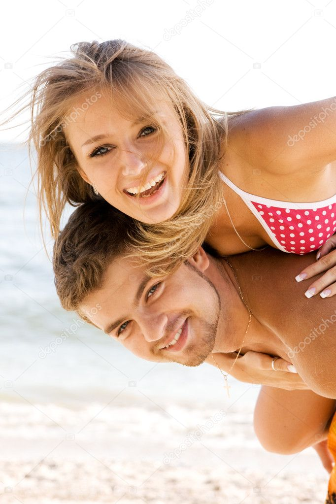 Beautiful young couple having fun on the seaside — Stock Photo #5758177